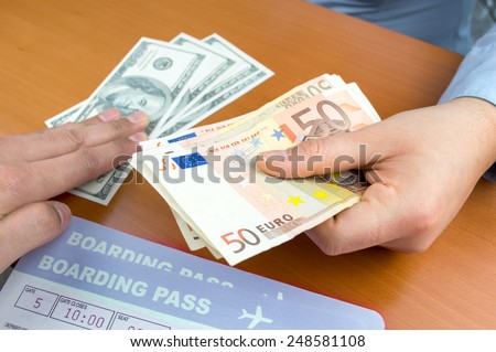 close up a money changing hands of people in an airport - stock photo