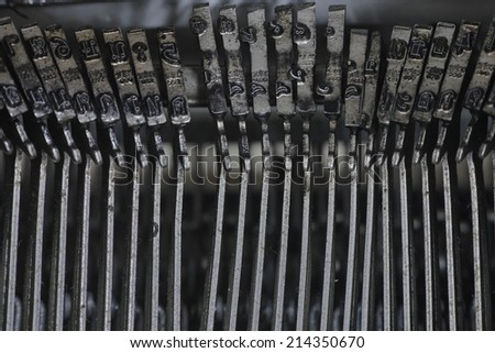 Close up a part of old Thai typewriter - stock photo