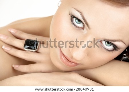 Close up a portrait of the beautiful woman with the jewelry, isolated - stock photo
