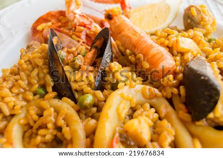 close up a traditional spanish rice paella with sea food  - stock photo