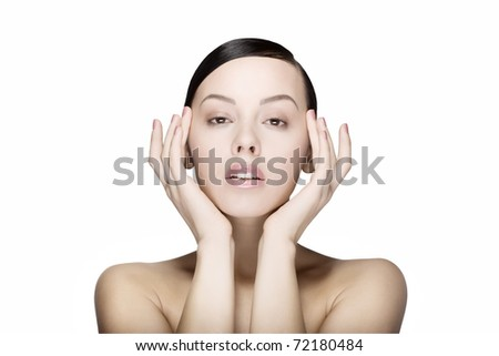 Close up a young beautiful brunette girl with hands near her eyes isolated - stock photo