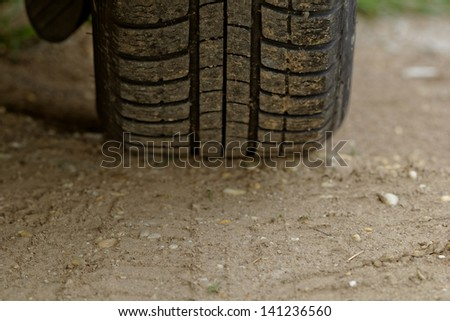 close up about car wheels on a dusty road