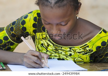 Close-Up African Ethnicity Teenage Woman Drawing with Colorful Pencils Mali (Schooling Education Symbol) - stock photo