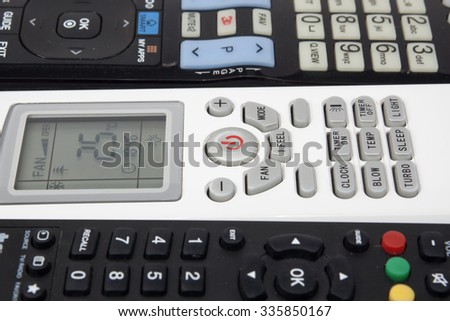 Close up air conditioner remote control on TV remote background