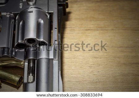 close -up air gun on old wood background - stock photo