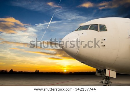 Close up airplane with twilight time - stock photo