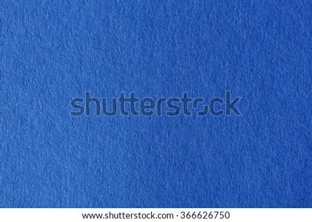 Close up aka macro shot of blue construction paper. - stock photo