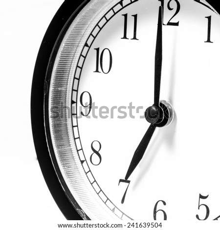 Close up alarm clock. Black and white image. - stock photo