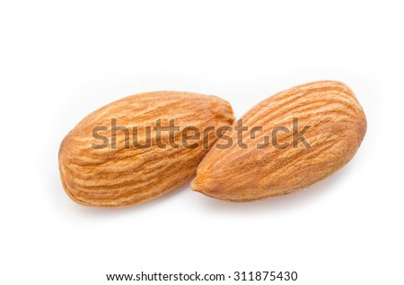 Close up almonds isolated on the white background