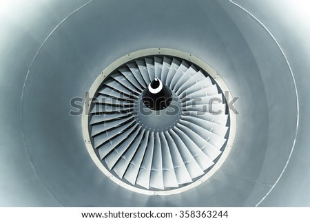 Close up and detailed view of airplane engine turbine blades.