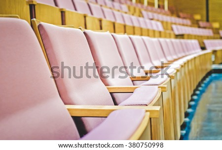 Close up and selective focus of Empty rows of armchairs in hall/ Color effect image - stock photo