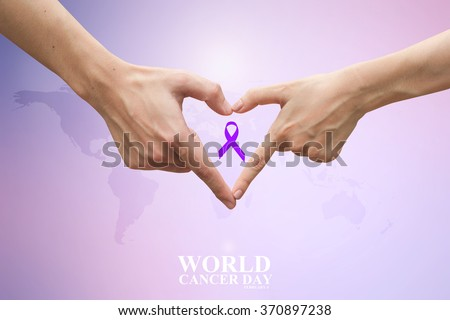 close up and selective focus on man/woman hands make heart shape over purple ribbon and blur map background:world cancer day concept:cheerful/hope/love idea:helping and prevent cancer awareness. - stock photo