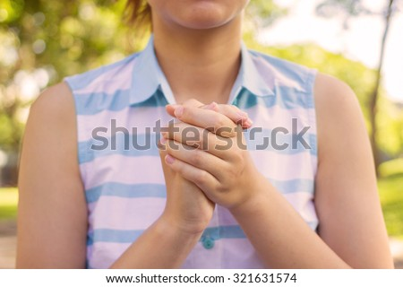 close up and selective focus on woman hands are praying to the heaven:woman believe in religion and try to pray for blessing from god:hands gesture pray:faith and religious concept.instagram effect. - stock photo