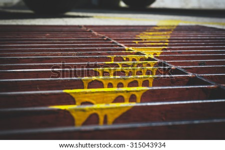 close up and selective focus  painted Yellow color for marking on steel grating,vintage style