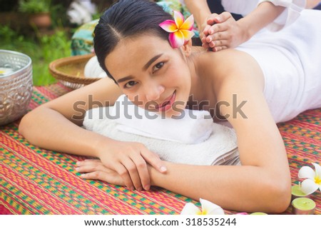 close up and selective focused young beautiful asian woman lying for massage :Thai woman in spa treatment :woman relaxing wellness concept.natural outdoors spa treatment concept.healthy life concept. - stock photo