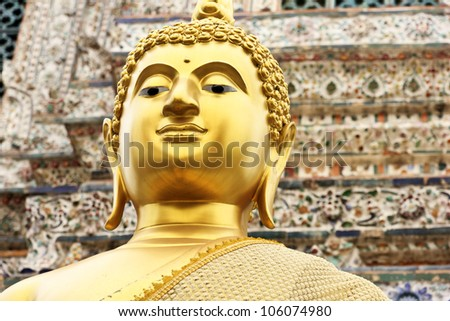 Close-up angle of the face of a Buddha head at the Wat Arun, Bangkok, Thailand. - stock photo