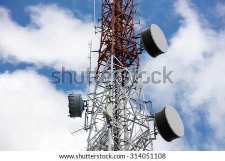 Close up antenna repeater tower on blue sky. - stock photo