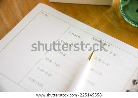 close up appointment page with pen - stock photo