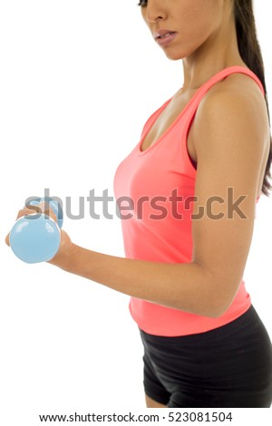 close up arm and hand of young attractive happy latin woman in sport clothes holding weight dumbbell doing fitness workout isolated on white background in healthy lifestyle concept
