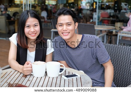 close up asian couple dating at outside restaurant:lovely young teenager felling happy in romantic time concept:happy good relationship of people city lifestyle:friendship:puppy love:sweet hour day.