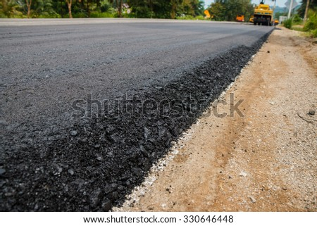 Close-up asphalt at the road under construction. - stock photo