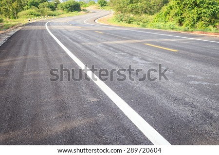 Close up asphalt road texture with white stripe - stock photo