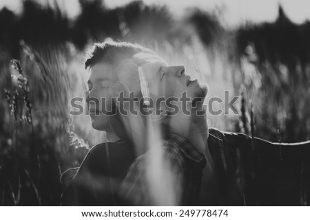 Close-up. Attractive gay couple black and white - stock photo