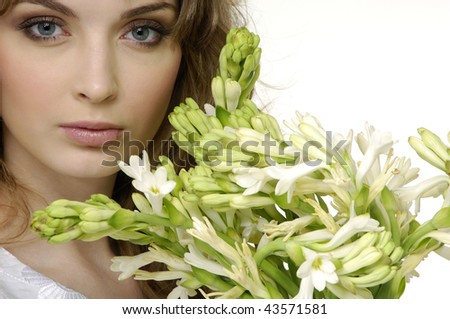 Close up attractive woman with orchid