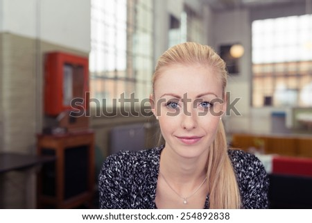Close up Attractive Young Blond Woman Looking at the Camera with Smile on her Face. - stock photo