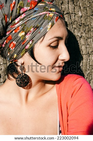 Close up Attractive Young Woman with Head Dress Fashion Facing Right Frame. - stock photo