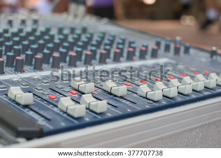 close up audio mixing console and faders on soft focus of  faders and def of field effect - stock photo