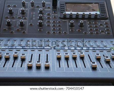 Close up audio mixing control panel