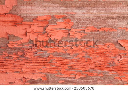 Close up Authentic Wooden Wall with Peeling Off Red Paint for Backgrounds - stock photo