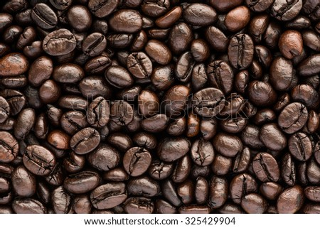 close up background and texture of brown coffee beans - stock photo