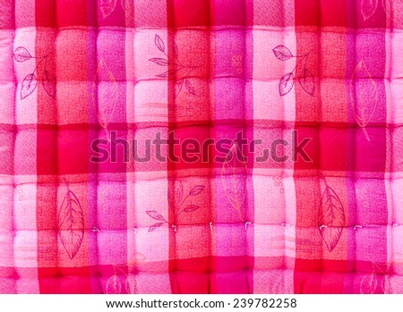 Close up background beautiful pink and white corrugated bed quilt. - stock photo