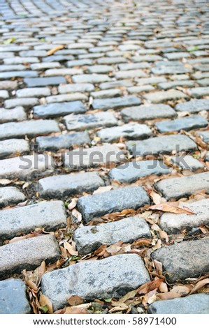 Close up Background Detail of a Cobbled Street with Shallow Depth of Field - stock photo