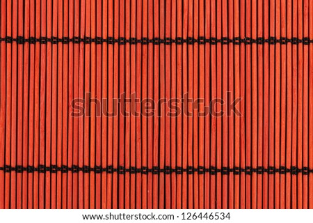 Close up background from red bamboo table cloth - stock photo