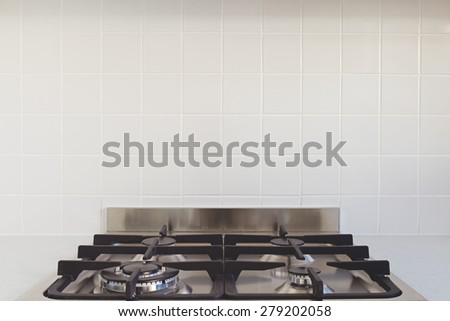 Close up background of tile splashback in contemporary kitchen - stock photo