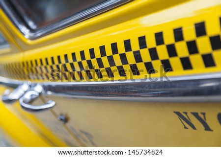 Close up background photograph of the side of New York City Yellow Taxi Cab - stock photo
