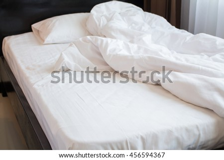 Close up background sheet bedspread with a white blanket, Messy bed concept
