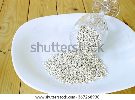 close up barley on white plate.Selective Focus on barley. Shallow DOF. - stock photo