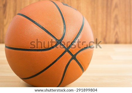 Close up Basketball on wooden floor background - stock photo