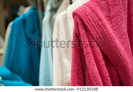 Close up bathrobes in the shop clothes - stock photo