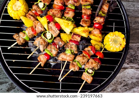 Close up bbq and corncob on a grilling pan, View top