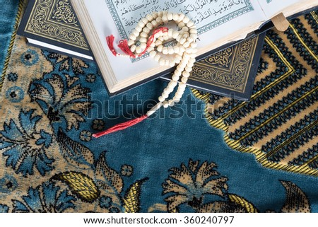 Close up beads and Islamic Book Holy Quran