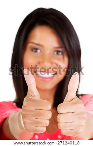 Close up beautiful mulato woman gesturing thumbs up - stock photo