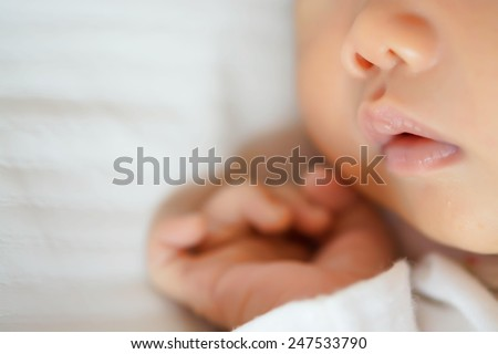Close-up beautiful sleeping baby girl - stock photo