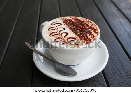 close up beautiful top dressing fern leaves pattern of moccachino coffee new zealand style