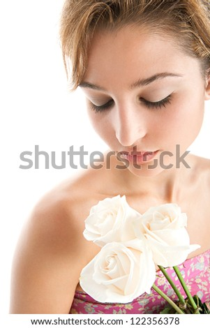 Close up beauty detail view of a young woman holding three perfectly shaped white roses, isolated on a white background. - stock photo
