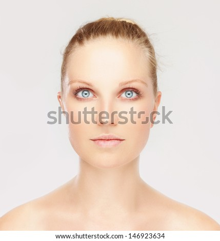 Close-up, beauty portrait of a calm, beautiful, young woman looking at camera. - stock photo
